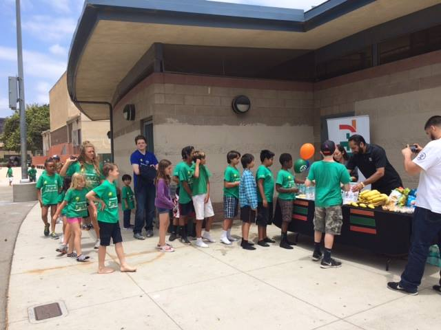 Kids line up for snacks at Stoner Park Pool.
