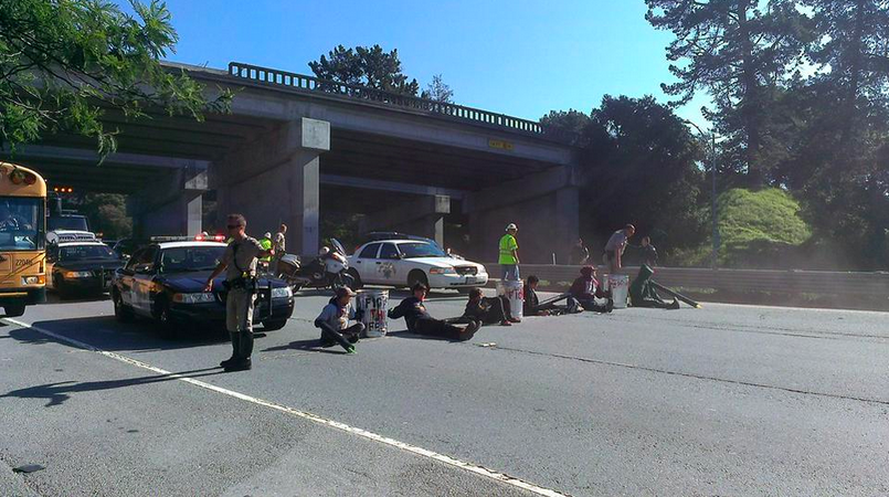 Student protesters block Highway 1 in a display of civil disobedience.