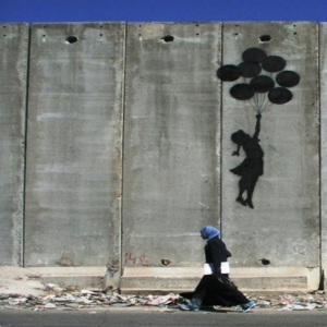 """Balloon Debate"" by Banksy on Palestinian Wall"