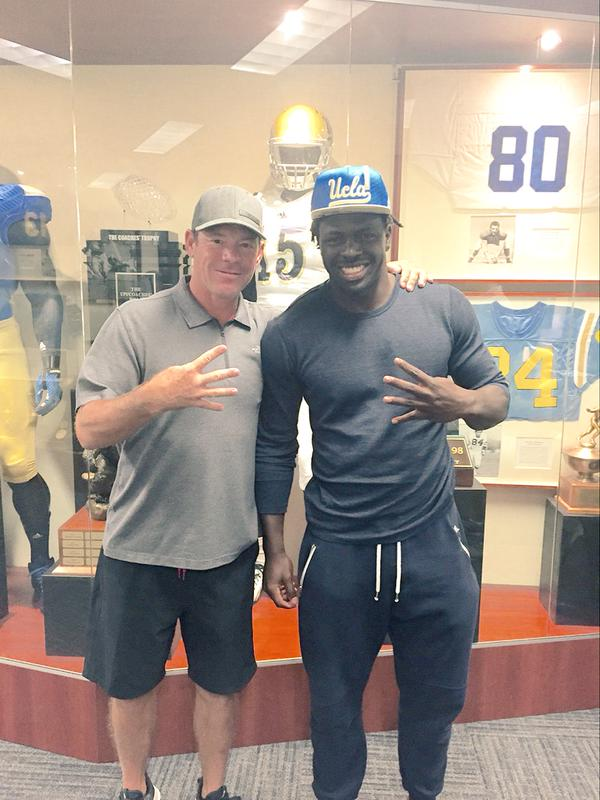 Oluwole Betiku poses with UCLA football head coach Jim Mora, celebrating his decision to attend