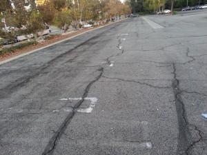 Broken asphalt in the Promenade parking lot.
