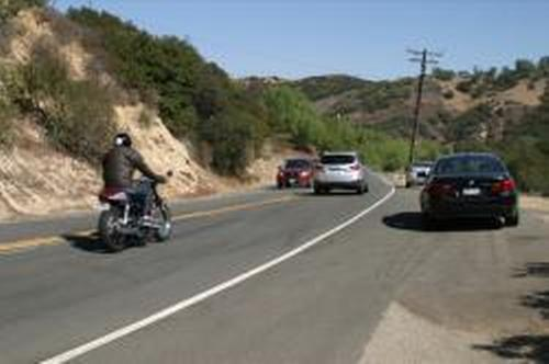Collision on Pacific Coast Highway between a motorcycle and car causes one critical injury.