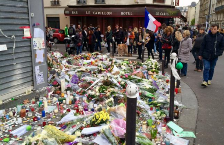 Parisians gather and create memorials across the city to honor the victims of the November 13 attacks.