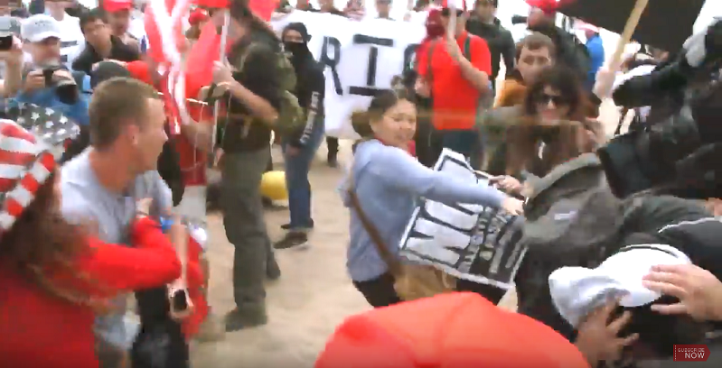 A screenshot showing an antifa demonstrator pepper spraying one of the men who attacked OC Weekly journalist Frank Tristan.