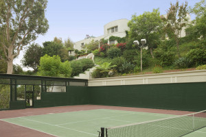 A tennis court seen in the backyard of the property. Photo courtesy of Caldwell Banker.