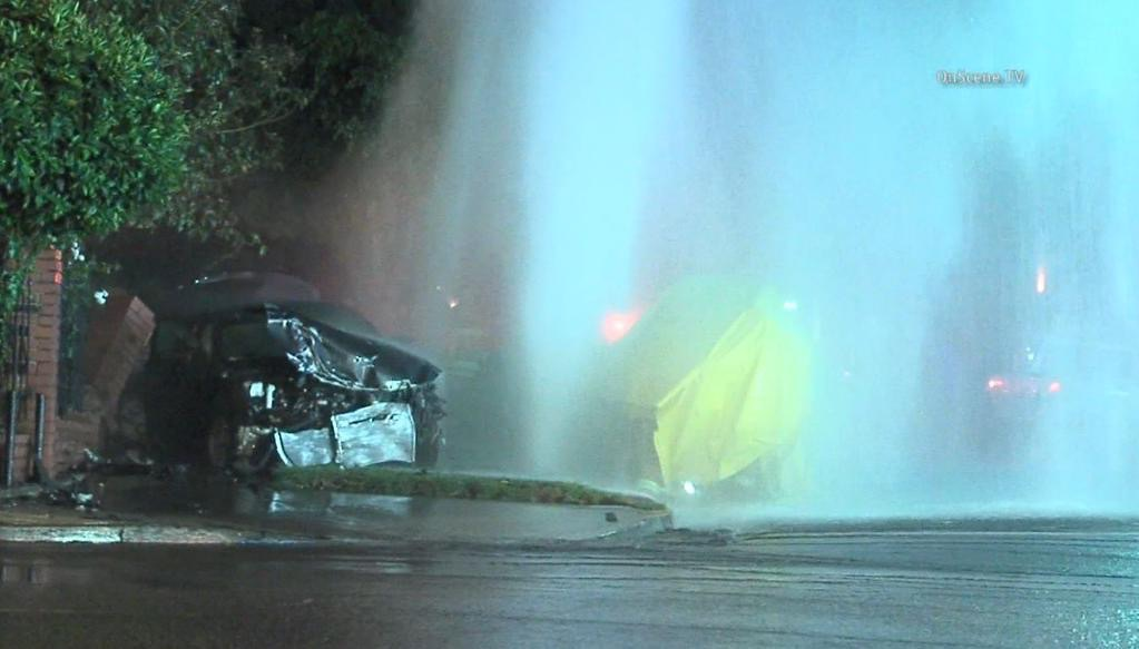 The impact of the alleged DUI crash not only decimated the victim's Honda Accord, but also a nearby fire hydrant, sending a geyser of water high into the air. At least one person was saved from the drenched vehicles in a first-response rescue effort.
