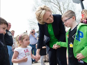 Hillary Clinton speaking with children.