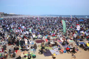 People swarm the beach to relax and listen to the show.
