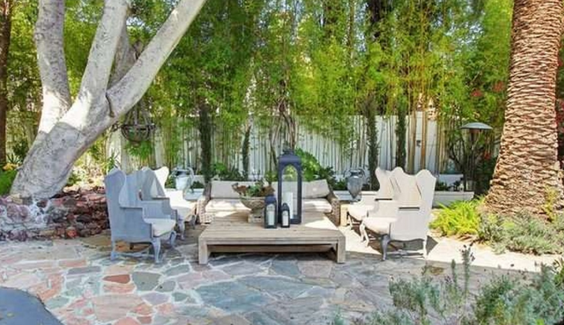 The house's backyard features a porch area, which overlooks Los Angeles and the ocean.