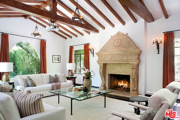 Wolfgang Puck's open-style living room with beamed ceilings, hardwood floors and French doors