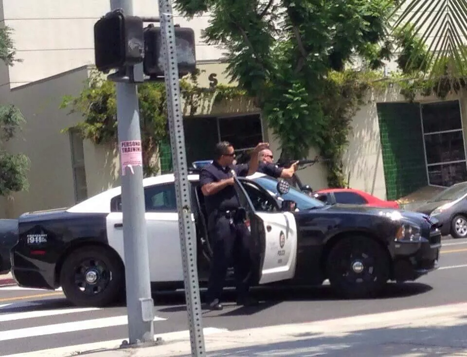 Cops respond to reports of a bank robbery in Los Feliz. Photo via Twitter @MsFatimaMalik