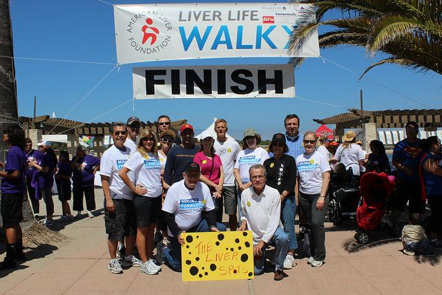 The team, The Liver Spots, pose at the finish line