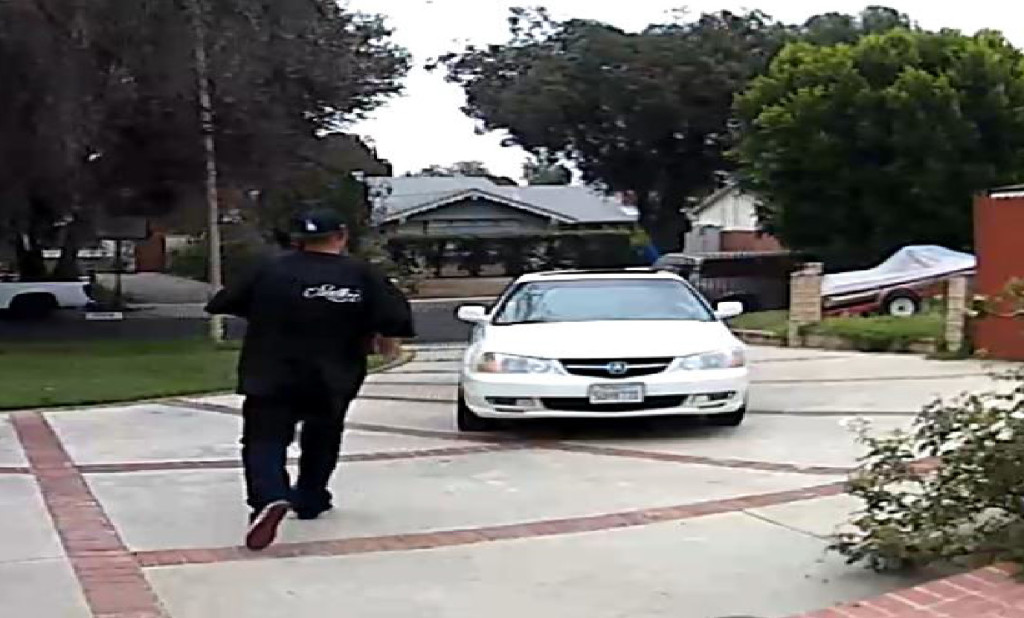 Image of one of the suspects and the vehicle that has been spotted stealing packages. Photo courtesy of the LAPD.