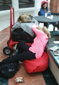 A homeless woman sleeps with her cat on the lower level of the Promenade.