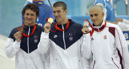 Michael Phelps with the GOLD Photo Courtesy Wikimedia Commons