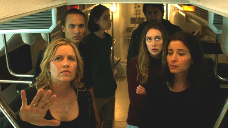 """The cast of """"Fear the Walking Dead"""" waits below deck for the officers to accept payment and grant passage into Mexico."""
