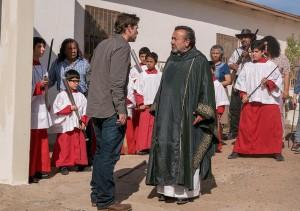 Thomas Abigail (Dougray Scott) confronts the parishioners outside of the church.