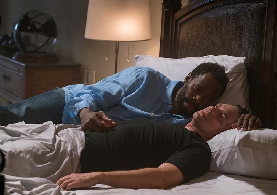 Thomas Abigail (Dougray Scott, right) is mortally ill and Victor Strand (Colman Domingo, left) comforts him.