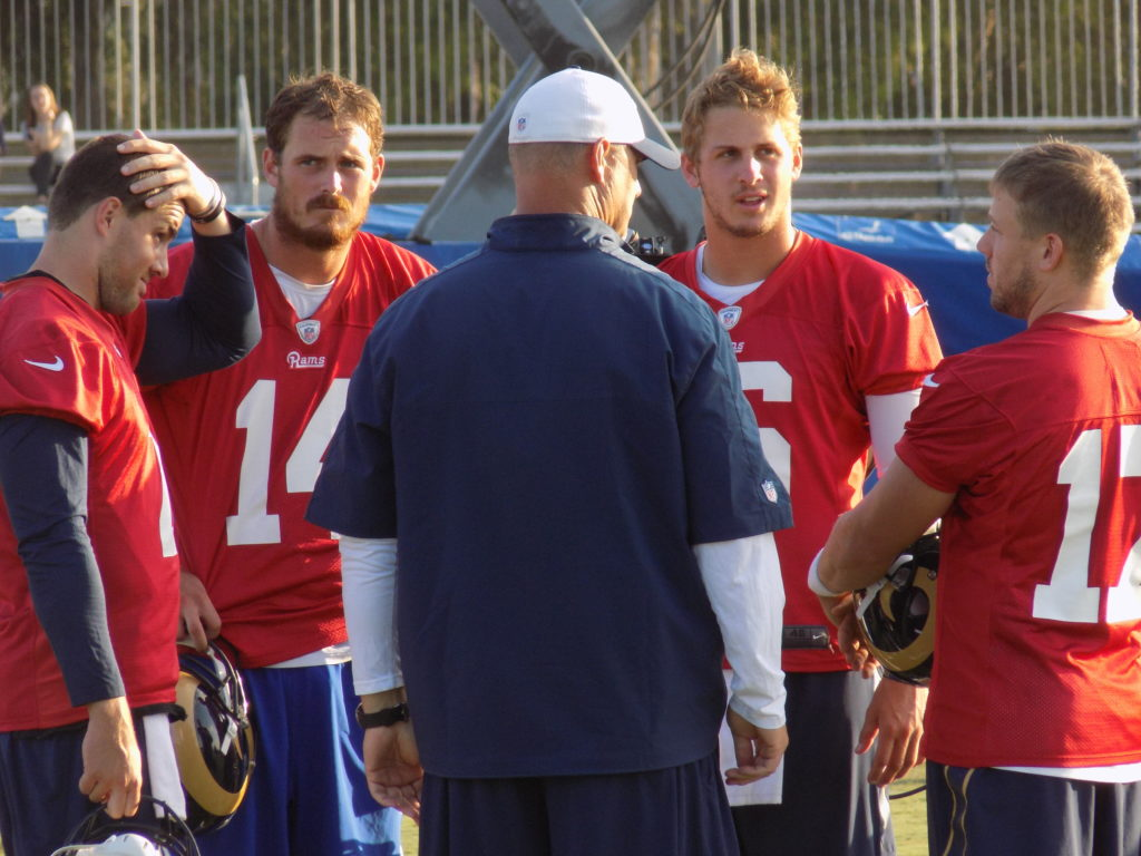 The Quarterbacks talk to the coach, including starter Case Keenum and Number one overall pick Jared Goff at the final day of the Los Angeles Rams Camp in Irvine, Ca. (Photo: Michael C. FLoch)
