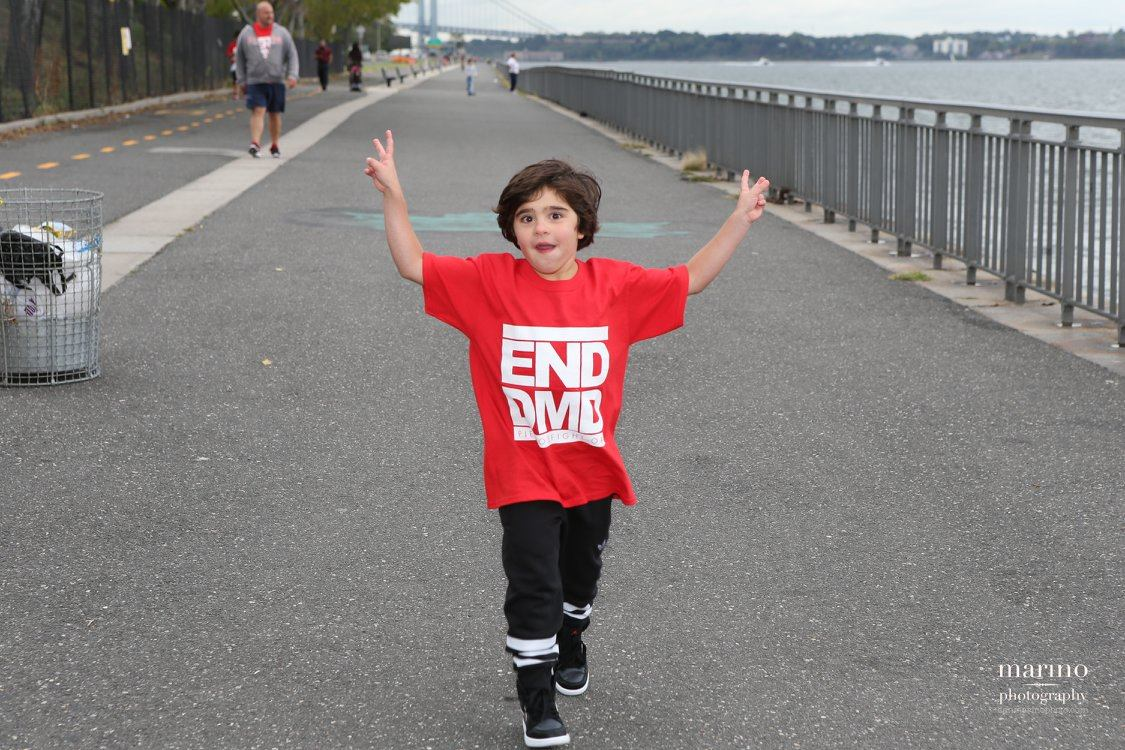 Pietro Scarso, 7, crosses the finish line to celebrate the FDA's announcement of the approval of Eteplirsen, the first drug ever made available to patients with Duchenne muscular dystrophy. Photo by: Marino Photography