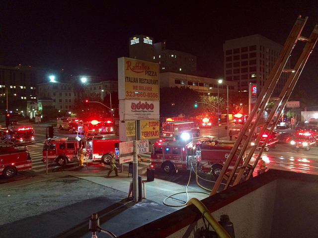 The Los Angeles Fire Department at the scene of the fire in Hollywood fighting the flames Source: https://www.flickr.com/photos/lafd/33309148031/in/album-72157681409763165/