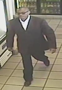 Footage of first suspect involved in the theft.  Photo courtesy of the LAPD.