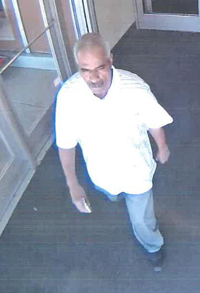 Footage of the second suspect involved in the theft.  Photo courtesy of the LAPD.