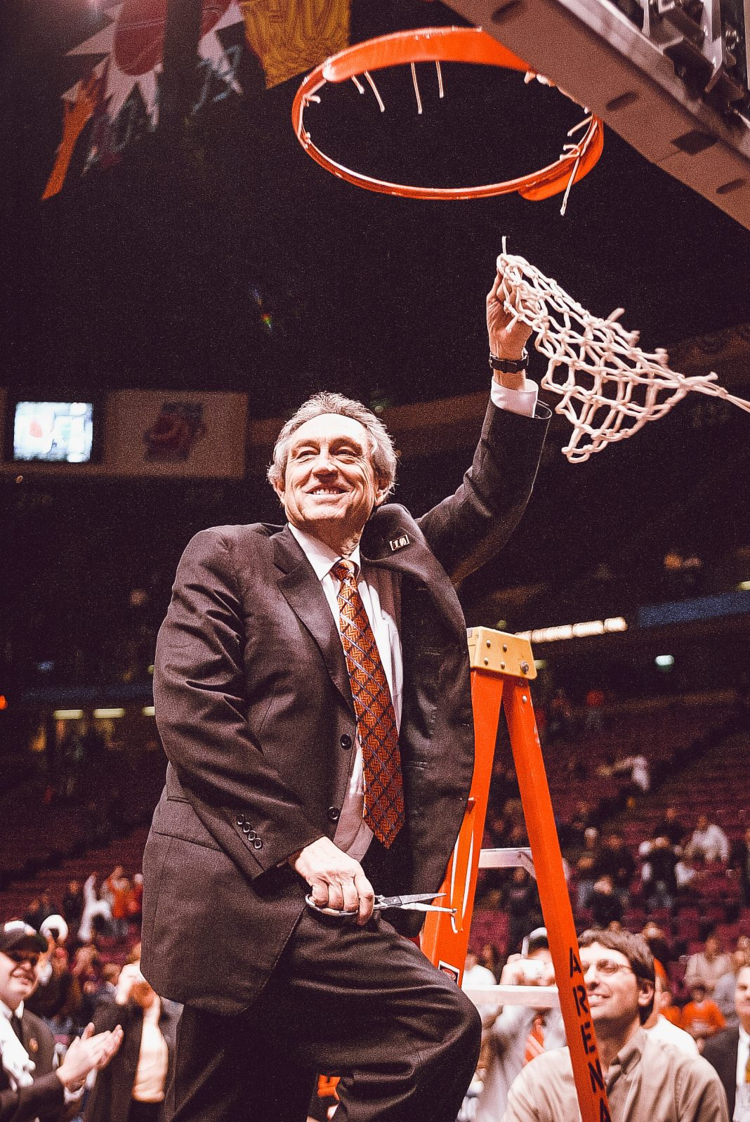 Eddie Sutton cuts down the nets after advancing to the Final Four.
